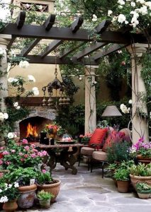 Chairs with fire place and a variety of plants