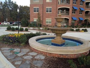 outdoor water fountain with flowers