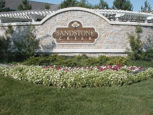 flowers in front of Sandstone Creek Apartment Homes