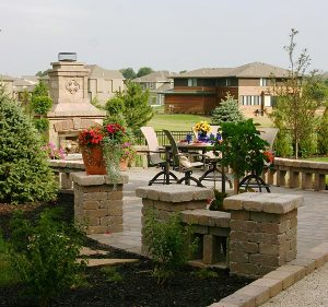 residential back yard area with chairs and fire place