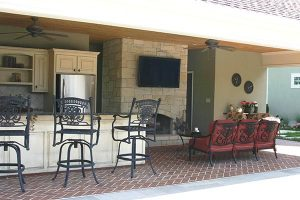 outdoor entertainment area with chairs and kitchen area
