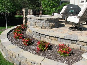 row of flowers near fire pit and outdoor patio