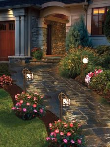 front yard path with flowers and lights