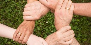 Four Hands Grasping Each Other