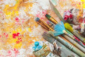 paint brushes with different paint colors