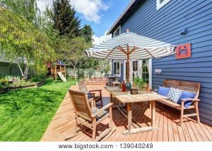 Patio outdoors with chairs and umbrella